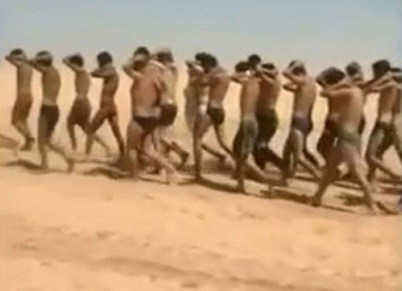 Young men in underwear being marched barefoot along a desert road before being allegedly executed by Isis