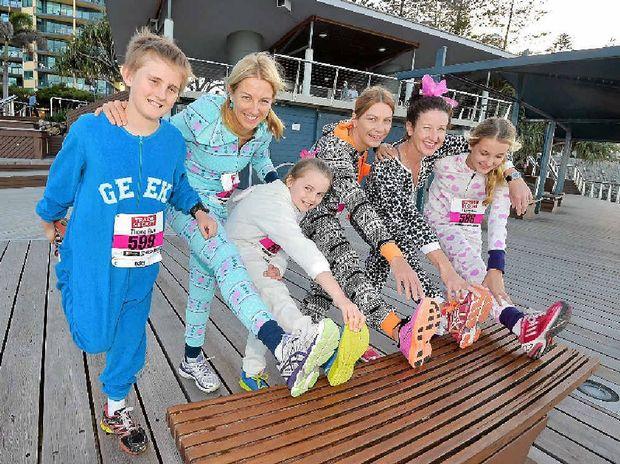 RUNNING IN STYLE: The Onesie Runsie kicks off the Sunshine Coast Marathon. (From left) Ben Carey, Fiona Pelly, Sabina Carey, Dana Craven and Jess and Alicia Baird.