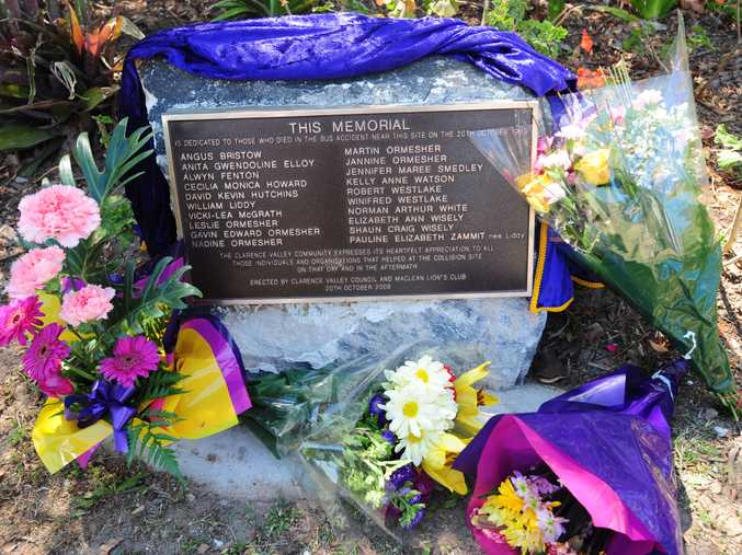 A Pacific Highway roadside plaque marks where the Cowper Bus crash occurred on October 20, 1989.