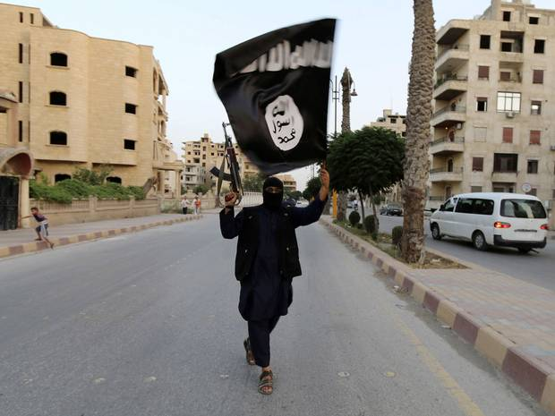 Man flies flag of the Islamic State