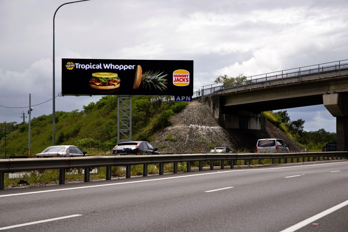 A digital billboard over the Gateway Motorway