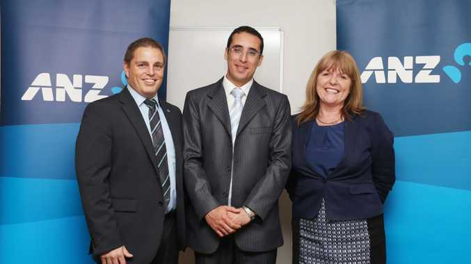 Joseph is the first refugee employee at ANZ Maroochydore. (L-R) Peter Folley, Joseph and Vicki Clark.