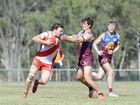 Yeppoon player Cameron Watkin pushes past a Glenmore player in the afl game at Stenlake Park on Saturday 30 August 2014. Photo: Chris Ison / The Morning Bulletin