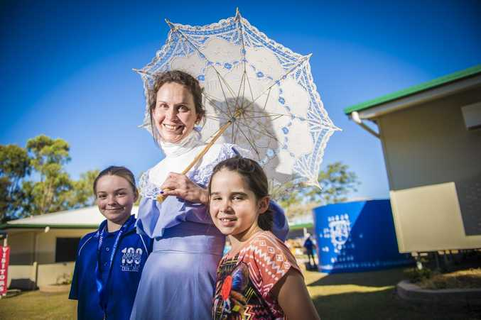 Grace Chadburn, grade five student at Ambrose State School, Amanda Stirling in period costume, senior teacher at Ambrose State School, Erin Stirling, 8, grade 2 at Ambrose State School.