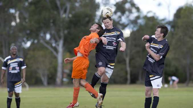 AERIAL CONTEST: South Hawks' Damo Saunders and West Wanderers' Mark Robinson compete for the ball during their minor semi-final at Middle Ridge Park.