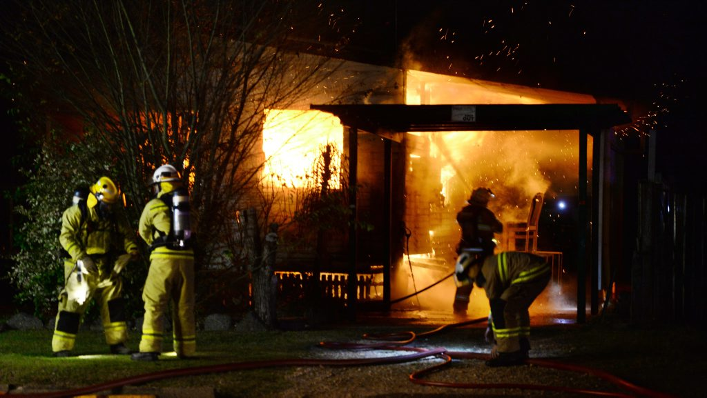 Fire fighters tackle a blaze at a house on Chubb Street in One Mile early Monday morning. Photo: Rob Williams / The Queensland Times