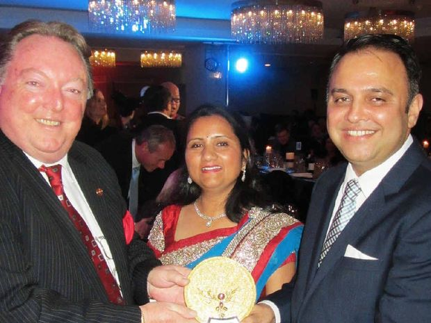 QUEENSLAND AWARD: Minister for Multicultural Affairs, Glen Elmes, presented Raj Sharma and his wife, Prianka, with his special award recognising their commitment to the Ipswich community.