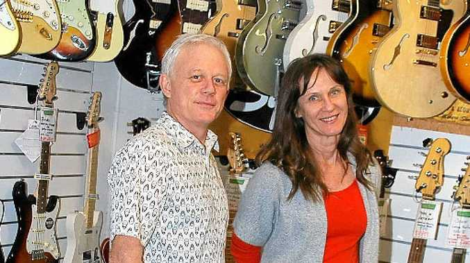 ROCK 'N' ROLL: Owners of Byron Music Craig Potter and Leonie Fulton. The Jonson St shop is for sale.
