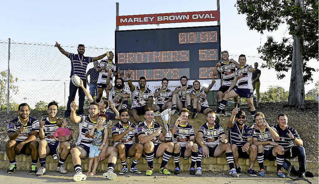 TOP TEAM: The Brothers A-grade players celebrate their 2014 Gladstone District Rugby League grand final trouncing of Valleys.
