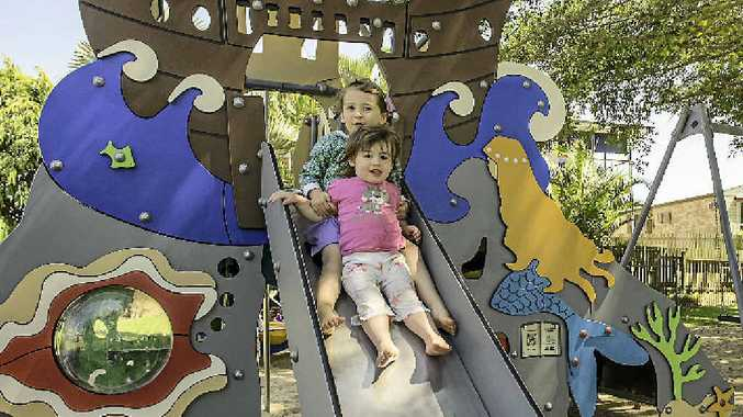 THIS IS GREAT: Ocean, 3, and River Claridge, 18 months, enjoy the new playground at Barney Point.