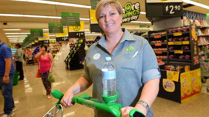 PUSHING FORWARD: Jodi Clifford, from Woolworths at Stockland Rockhampton, tries out one of the store's new shopping trolleys which comes with a drink holder.