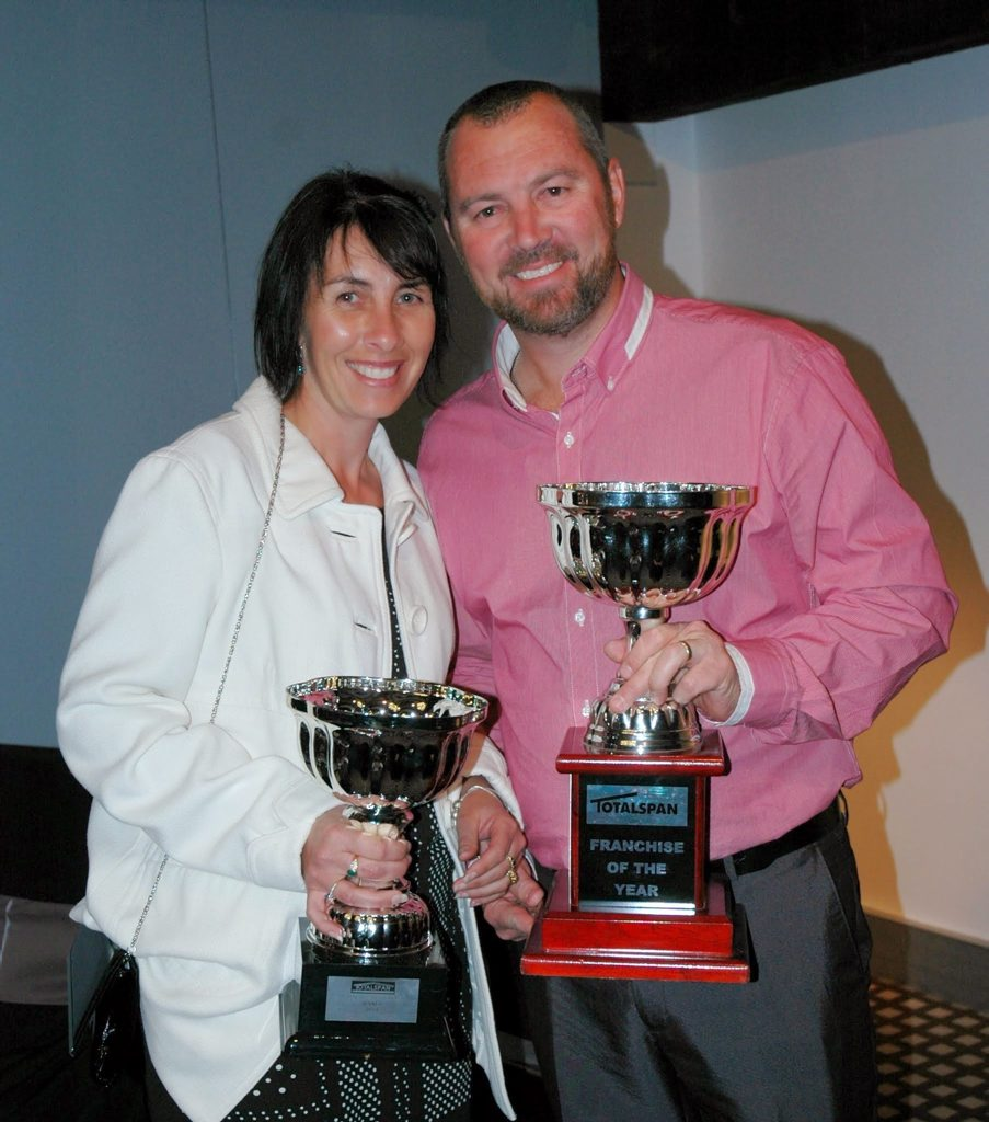 TOP DOGS: Penny and Nick Stuart pose with their National Franchise of the Year trophies at the Totalspan awards night.