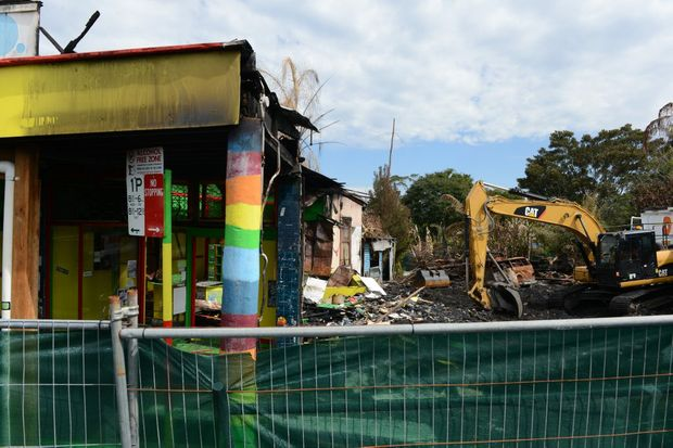 Crews began the demolition of the businesses destroyed by fire in Cullen Street, Nimbin.