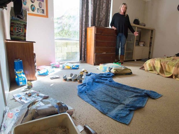UNSIGHTLY MESS: Lisa Greer is devastated to see the condition of her home.