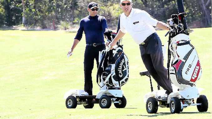 GREENS MACHINE: Darrell Dalton and Douglas Mizzi (above and inset) demonstrate the Golf Skate Caddy, designed to make it easier for golfers to navigate greens.