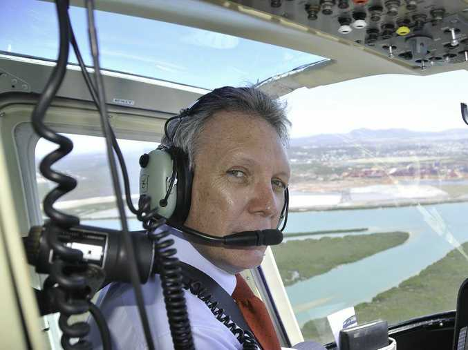 Energy Minister Mark McArdle in flight over Gladstone. Photo Andrew Backhouse / The Observer