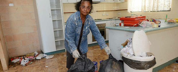 Iola Atterwell helps clean up the mess left by tenants in Alf Blana's Anderleigh house.