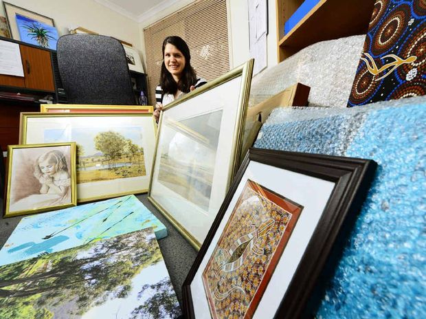 SMART ART: Organiser of the Ipswich Hospice Care Art Show auction Niccola Harwood with some of the work for sale.