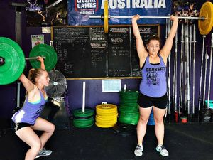 Heavy metal sisters off to weightlifting titles