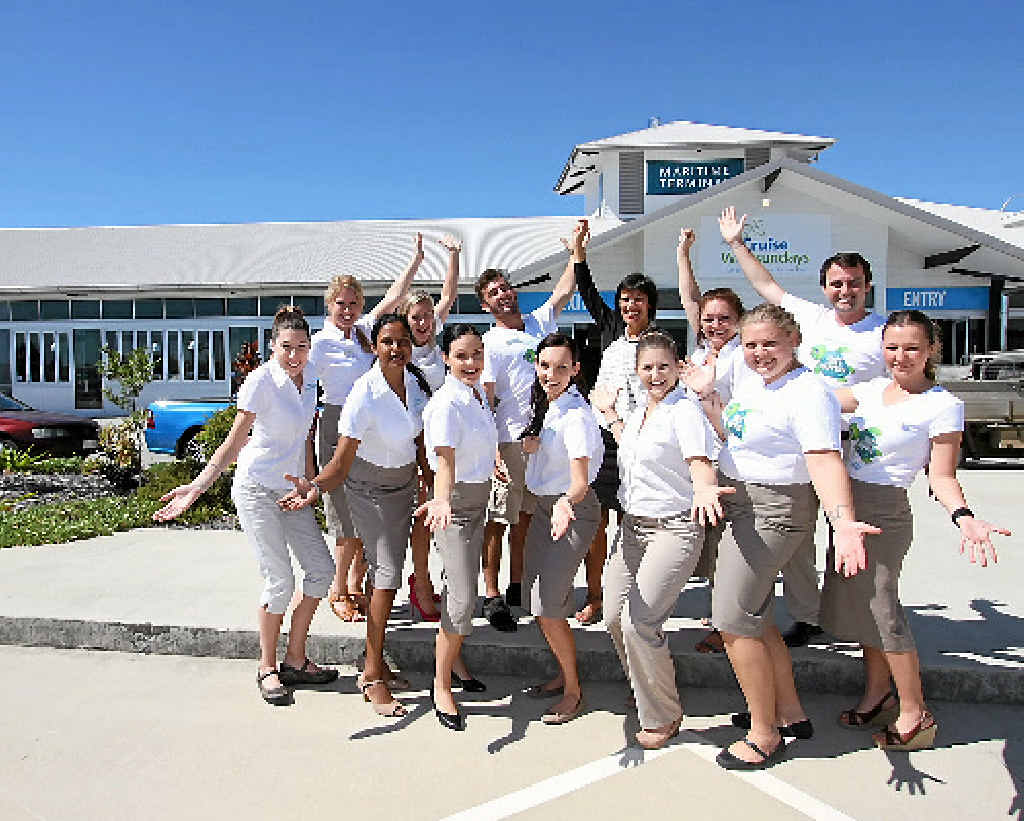 CELEBRATIONS: Cruise Whitsundays staff are loking forward to 'moving week' and sharing the new maritime terminal with visitors to the region and the local community. Pictured here in front of the terminal are: Alyce Carter, Danielle Krista, Nicholas Bates, Tracy Evans, Lisa Bates and Patrick Manning (back) and Deanna Cass, Veena Chand, Tayla Maranda, Elaine Scharneck, Alex Rolfe, Ashlee McNicol and Bianca Stow (front).