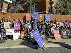 Protesters confront trio accused of cruelty