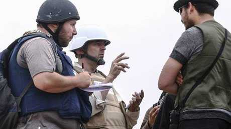 Journalist Steven Sotloff, left, pictured in Libya in 2011