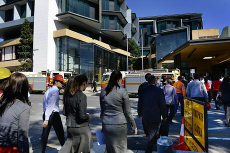People make their way back into the Ipswich Courthouse after it was evacuated on Wednesday morning. Photo: Rob Williams / The Queensland Times