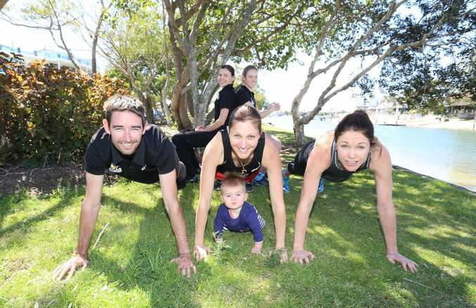 The team from Atlas Multisports are challenging Clive Palmer to come and train with them. (From left) Jason Crowther, Lisa Crowther with daughter Maya, Michelle Laforest and Kristin Lawrence and Bec Edwards (back) .