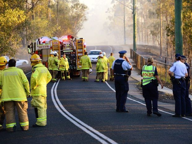 EMERGENCY: A firefighter was struck by a car on Bertha St in Goodna yesterday while attending a grass fire.