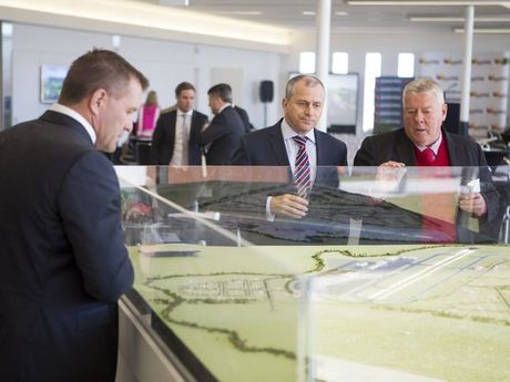 Overlooking a model of Wellcamp Airport are (from left) ambassador Shane Webcke, QantasLink chief executive John Gissing and Wagners chairman John Wagner.