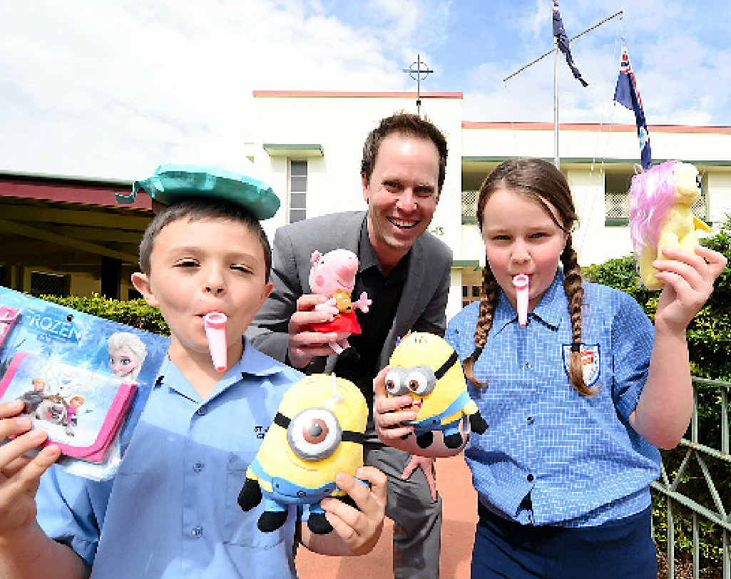 SCHOOL FETE: St Joseph's School students Tom Blinco (left) and Charlotte Bainbridge (right) join forces with principal John Hinton to encourage the community to attend the school's fete tomorrow.