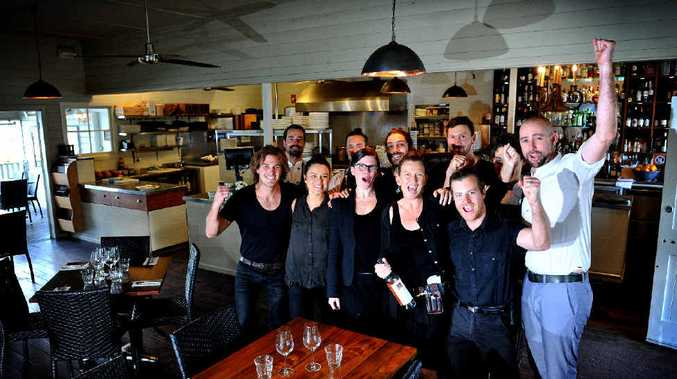 WE ARE THE CHAMPIONS: Some of the Harvest Cafe staff celebrating being awarded a prestigious Hat in The Sydney Morning Herald Good Food Guide.