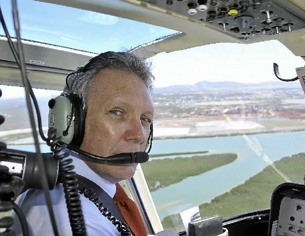 BIRD'S EYE VIEW: Energy Minister Mark McArdle during a flight over Gladstone.