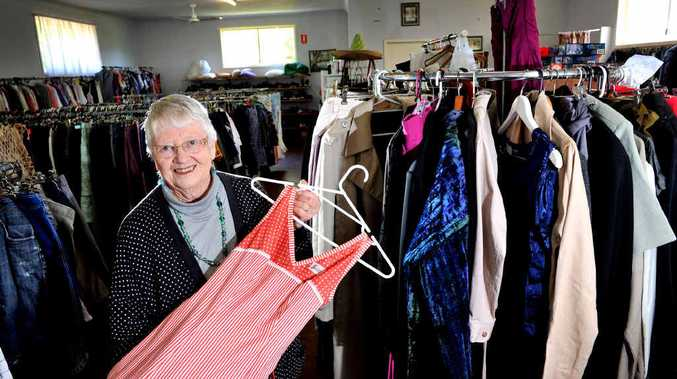 Bangalow Op Shop volunteer Joan Davies displays some of the spring collection to come into the store recently.