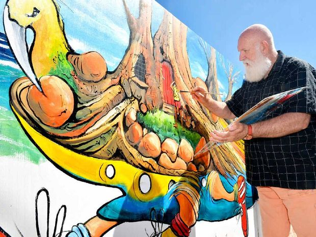 MURAL: Artist Donald Waters decided to add his own personal touch to the outside of Milton Picture Framers on Milton St. He took just over a day to paint the mural.