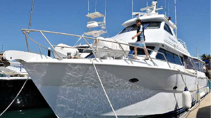 PICTURE PERFECT: Skipper Robert DePinto aboard Megaforce Charters boat at Mackay Marina. INSET: Mr DePinto with the extensive range of fishing gear available on Megaforce.
