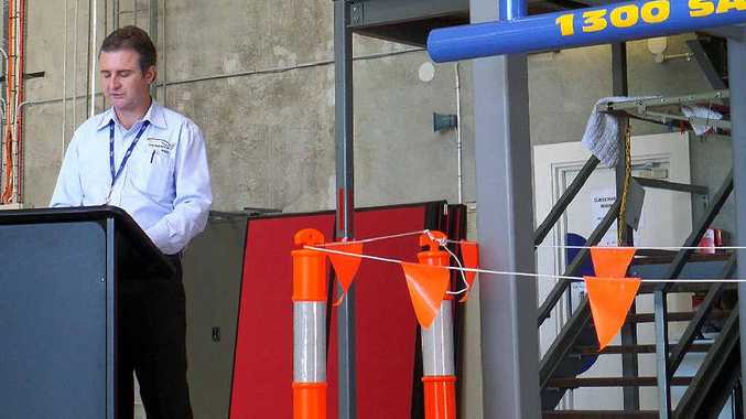 GRATEFUL: RACQ-CQ Rescue chief executive officer Martin Cleland speaks at the unveiling of the static winch training platform at the service's hangar.