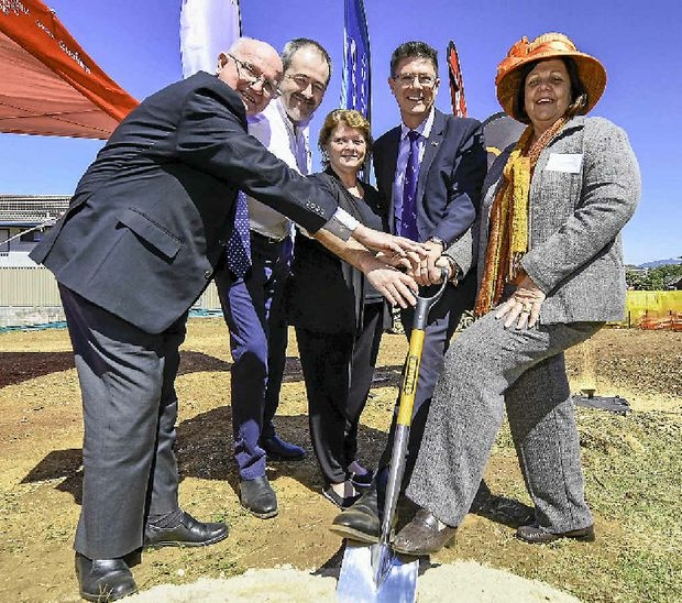 HISTORIC MOMENT: Turning the first sod in the construction of the $20 million affordable housing developments are GAH chairman John McAuliffe, QGC vice-president Brett Smith, MP Liz Cunningham, Assistant Minister for Planning Reform Rob Molhoek, and Mayor Gail Sellers.