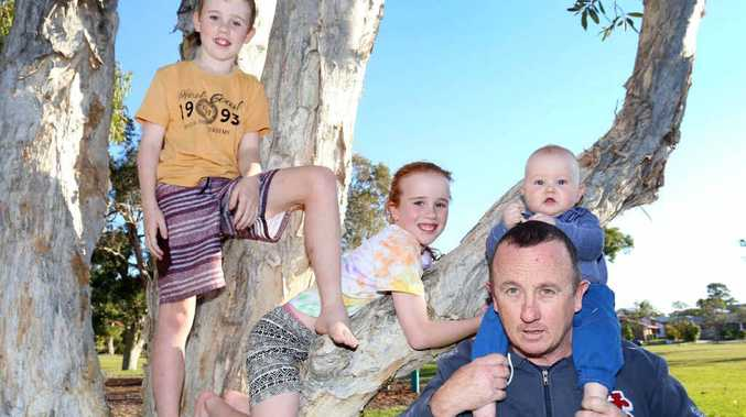 THAT'S BETTER: Brendan Raggett seen here with his children, Callum,11, Kelsey, 9, and Jonty, 9 months, has started a Facebook campaign to let kids be kids.