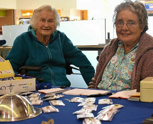 GIVING BACK: June Shannon and Mary Phipps look after the stall for Legacy Week in Dalby Shoppingworld, selling badges and taking donations until today.
