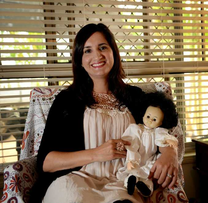 Fee Welch with her sisters doll. Photo Allan Reinikka / The Morning Bulletin