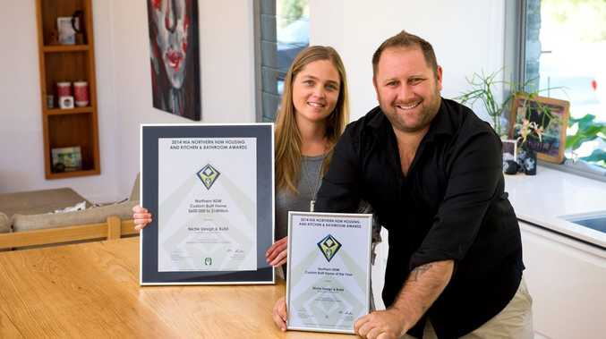 Niche design build win HIA award. Shelley Brauer and Nathan Whitlock with their award and house. Photo Trevor Veale / Coffs Coast Advocate