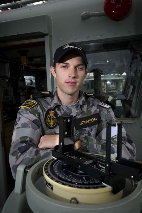 Royal Australian Navy officer Midshipman Ben Johnson takes a bearing using the compass on the bridge of HMAS Labuan during Exercise Croix du Sud 2014 in New Caledonia. (credit: Oliver Carter)