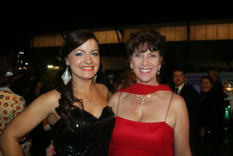 Heidi Schumacher and Liana Wynne loved dressing up for the Monte Carlo Spectacular casino night at the Gladstone PCYC.