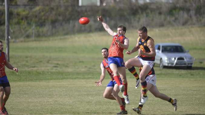 Warwick midfielder Brendan Iles (centre) helped his side earn an AFLDD grand final berth with three goals.