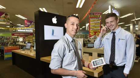 Rumours that new IPhone6 is to be released this week. Harvey Norman staff; Ben Peet and Tom Maguire. Photo: Bev Lacey / The Chronicle