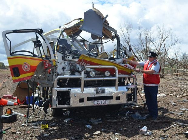 Queensland Fire and Emergency Services Inspector Warren Buckley assesses the damage to the Charleville branch's alpha vehicle.