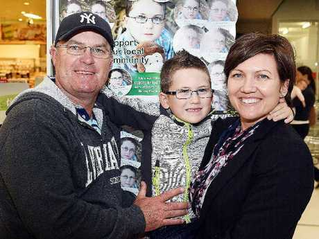 Five-year-old Cooper Christensen, pictured with parents Michael and Amanda, had terminal brain cancer and was the face of a Woolworths campaign to raise funds for Hervey Bay Hospital.