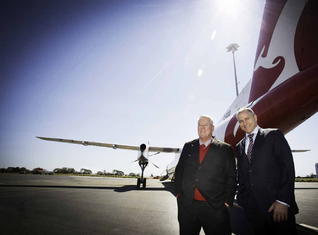BATTLE BEGINS: Wagners chairman John Wagner and QantasLink chief executive officer John Gissing in front of a Qantas Q400 aircraft that will service Wellcamp airport.