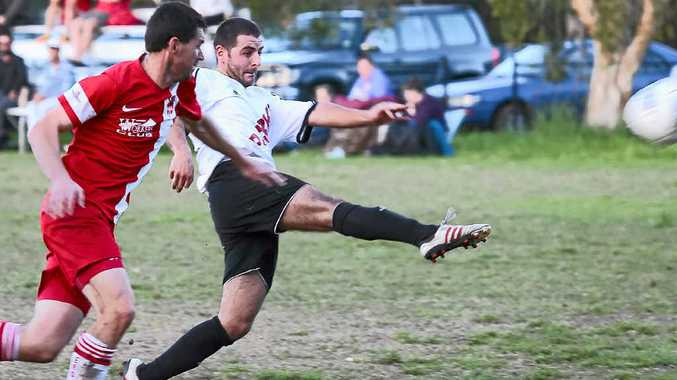 STRIKER: Connor Cannon (white shirt) will be doing all he can to get Byron Bay into a third consecutive grand final. The Rams play Richmond Rovers tonight.